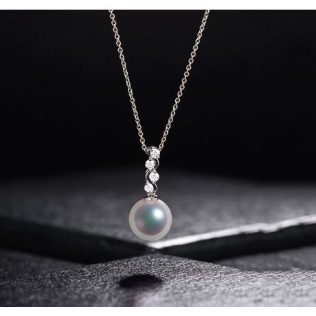 Pendentif danse du serpent. Perle Akoya, Or blanc, diamants.