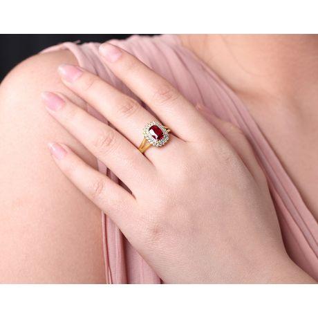 Bague rubis sertie d'une double rangée de diamants. Or jaune