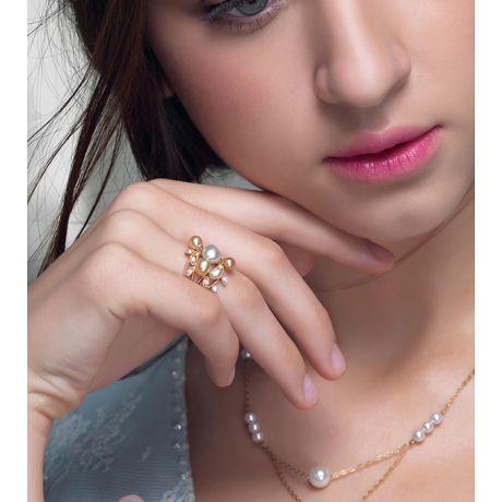 Bague secret flower first en perles d'Australie blanches et dorées
