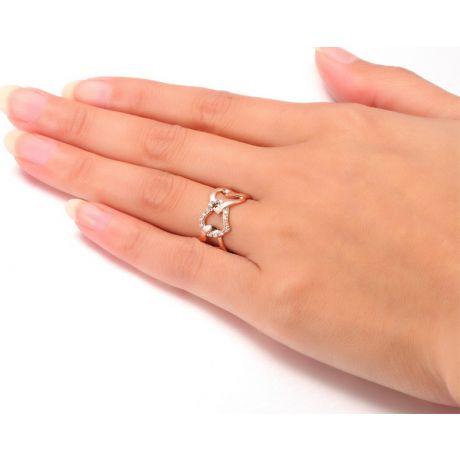 Bague or rose diamants en forme de succession de coeurs
