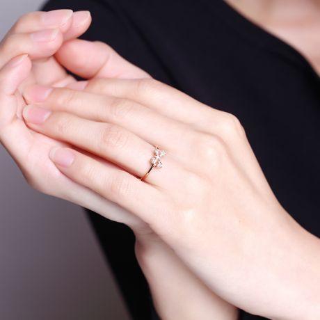 Bague petit noeud Or rose 18cts. Diamants 0.080ct