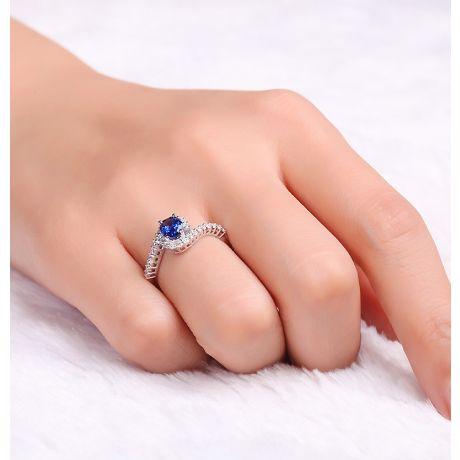 Bague saphir or blanc pavage diamant sinueux