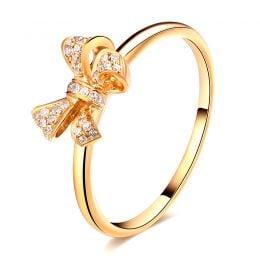 Bague petit noeud Or jaune 18cts. Diamants 0.080ct