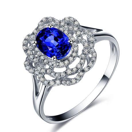 Bague fiancailles saphir bleu diamants. Or blanc, fleur éclose